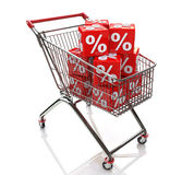 Shopping cart with cubes of percent Royalty Free Stock Images
