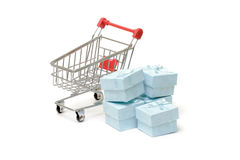 Shopping cart with cyan gift boxes Royalty Free Stock Photo