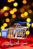 Shopping cart with decorative ball Royalty Free Stock Image