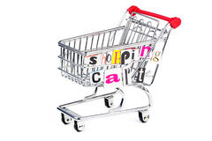 Shopping cart different way. Chrome shopping cart with funny letters on white background Royalty Free Stock Photography