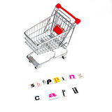 Shopping cart different way. Chrome shopping cart with funny letters on white background Stock Photo