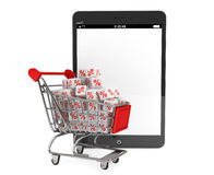 Shopping cart with discount cubes near Tablet PC Stock Photo