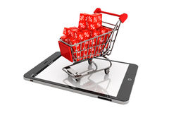 Shopping cart with discount cubes over Tablet PC Stock Photo