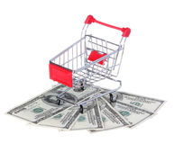 Shopping Cart on Dollar Bills isolated on white. Ttrolley on money Stock Photography