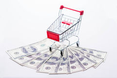 Shopping cart on dollar Stock Images
