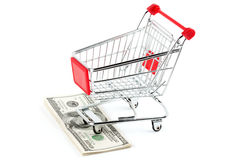 Shopping cart and dollars Stock Photo
