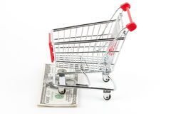 Shopping cart and dollars Royalty Free Stock Image