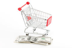 Shopping cart and dollars Stock Image