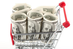 Shopping cart and dollars Royalty Free Stock Images