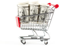 Shopping cart and dollars Stock Images