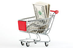 Shopping cart and dollars Royalty Free Stock Photo