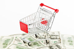 Shopping cart and dollars Stock Photography