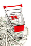 Shopping cart and dollars Royalty Free Stock Photo