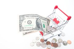 Shopping cart with dollars banknotes and coins isolated on white. Background, Financial concept Stock Photography