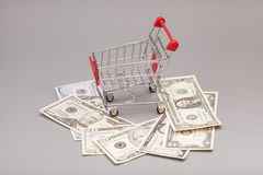Shopping Cart with dollars Stock Photo