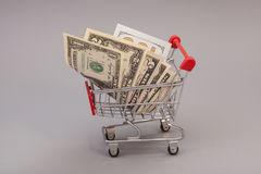 Shopping Cart with dollars Stock Photography