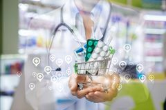 Shopping cart with drugs in the hands of a physician . royalty free stock image