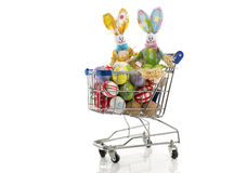 Shopping cart with easter eggs and bunny  isolated on white Stock Image