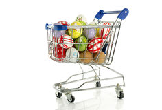 Shopping cart with easter eggs stock photos
