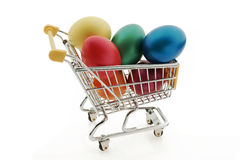 Shopping cart with easter eggs Royalty Free Stock Photos