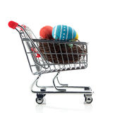 Shopping cart with easter eggs Royalty Free Stock Image