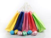 Shopping cart with easter eggs Stock Photos