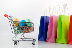 Shopping cart with easter eggs Stock Photo