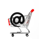 Shopping cart with email symbol Royalty Free Stock Image