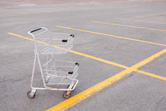 Shopping Cart. Empty shopping cart in empty parking lot Royalty Free Stock Images