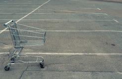 Shopping cart at empty parking at shopping mall royalty free stock photography