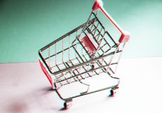 Shopping cart. Empty supermarket trolley on violet background. 90s style glitch effect. Shopping cart. Empty supermarket trolley on violet background Royalty Free Stock Image