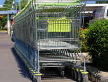 In shopping cart, enter the merchandise, cart wheels, facilities Stock Image