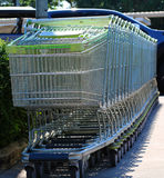In shopping cart, enter the merchandise, cart wheels, facilities Royalty Free Stock Photo