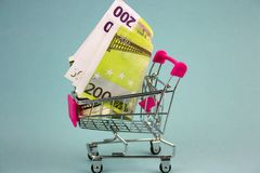 Shopping cart with euro. Banknotes royalty free stock image