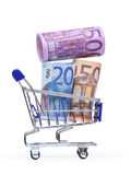 Shopping cart with euro banknotes Royalty Free Stock Photos