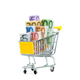 Shopping cart with euro banknotes on white Royalty Free Stock Photography