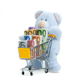 Shopping cart with euro banknotes on white Stock Images
