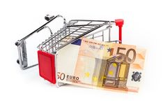 Shopping cart with 50 euro bill inside. Shopping cart is upturned, concept symbol of bankruptcy, crisis and other Stock Photography