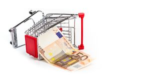 Shopping cart with 50 euro bill inside. Shopping cart is upturned, concept symbol of bankruptcy, crisis and other Royalty Free Stock Photography