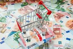Shopping cart and euro bills Stock Photo