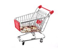 Shopping cart with euro coins in it Stock Image