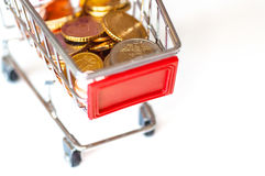A shopping cart with euro coins Stock Image
