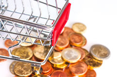 A shopping cart with euro coins. Symbolic photo for purchasing power and consumption Royalty Free Stock Photo