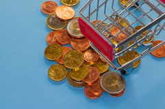 A shopping cart with euro coins. Symbolic photo for purchasing power and consumption Stock Photo