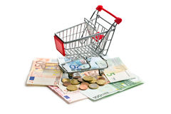 Shopping cart on euro currency Royalty Free Stock Images