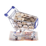 Shopping cart Euro notes and euro coins isolated on white Royalty Free Stock Photography