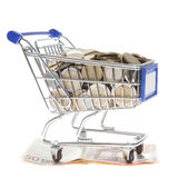 Shopping cart Euro notes and euro coins isolated on white Stock Photo