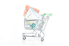 Shopping cart with Euros, isolated on white Royalty Free Stock Photography