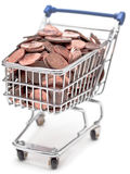 Shopping cart filled with British pennies. A toy shopping trolley containing British one pence and two pence pieces royalty free stock photos