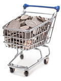 Shopping cart filled with British silver coins. A toy shopping trolley containing British five, ten and twenty-pence pieces stock images